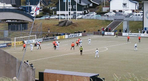 B36 Tórshavn playing Skála in Gundadalur Stadium. B36 in white - Skála in orange. Action here: B36 almost scoring after a free kick.