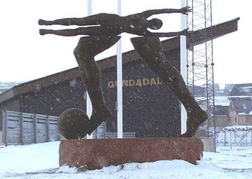 Hans Pauli Olsen's sculpture outside the gate at Gundadalur Stadium