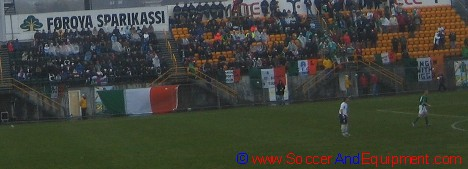 Irish supporters sitting in the rain at Tórsvøllur Stadium in Tórshavn, Faroe Islands