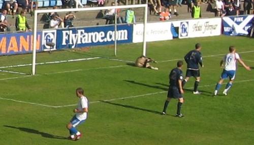 Scottish goalkeeper Craig Gordon saves the shot from Súni Olsen