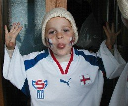 Bogi Petersen, 3 years old in 2002, in a Faroe Islands replica soccer jersey, ready for a match against Germany