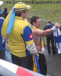 Ukranian supporter stripped to the waist, celebrating his country's victory - yvirkroppaball
